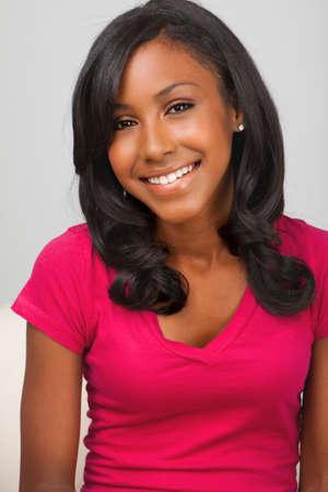 African American teenage girl smiling.