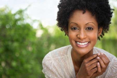 Beautiful woman smiling outside.