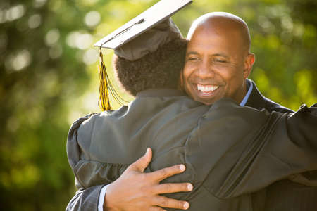 Father hugging his son at his graduation.