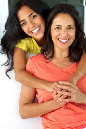 Happy hispanic mom and her daughter.