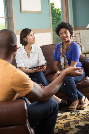 Small community group in a support group. Stock Photo