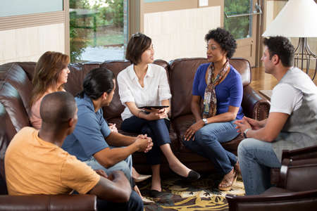 Small community group in a support group. Imagens