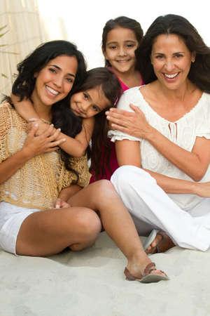 Three generations of hispanic woman smiling.