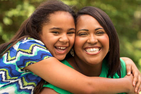 Happy African American mother and daughter.