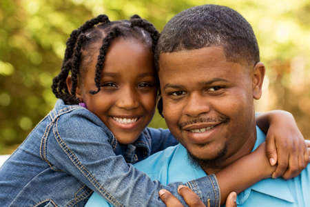 Happy African American father and daughter. Imagens