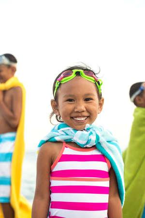 Asian kids playing on the beach. Stock fotó