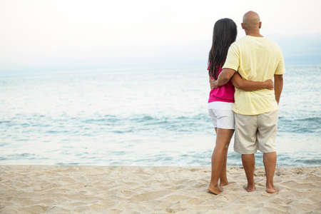 Rear view of a couple on the beach. Stock Photo