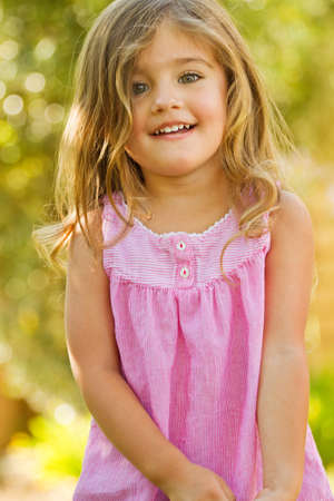 Cute little girl outside smiling. Stock Photo