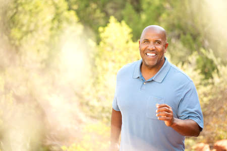 African American man jogging outside. 스톡 콘텐츠