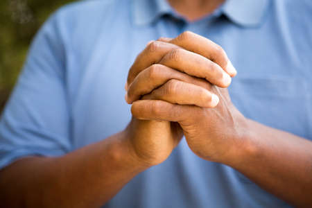 African American man in deep thought in prayer and worship.