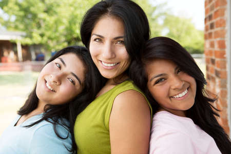 Hispanic mother and daughters. Stock Photo