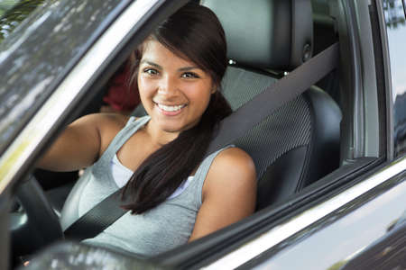 Young teenage girl driving. Stock Photo