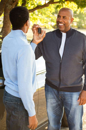 Father teaching his son how to drive. Stock Photo