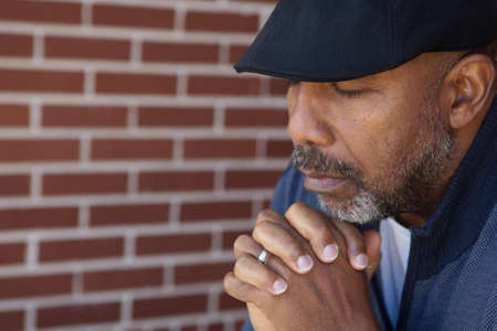 Mature African American man in deep thought.