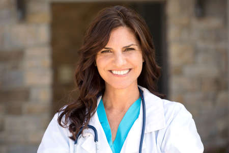 Healthcare worker standing outside the hospital. Stock Photo