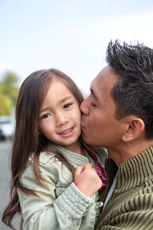 Asian father with his daughter.