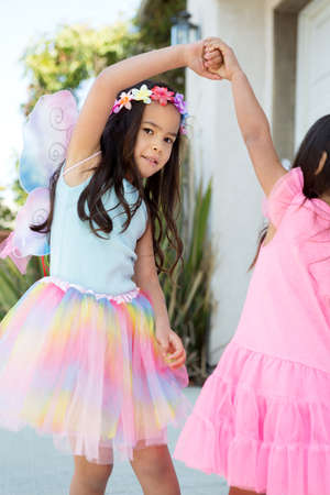 Cute little girl dressed up as a fairy.