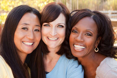 Diverse group of women talking and laughing. Stock Photo