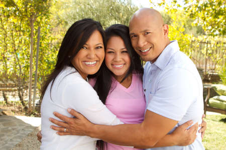 Happy Asian Family Hugging