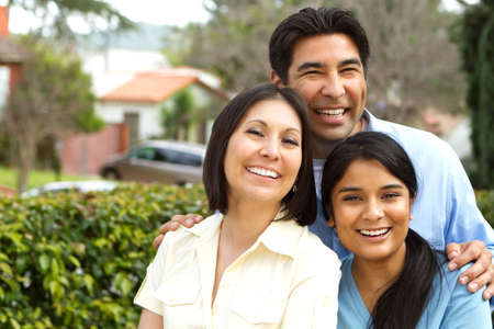 Hispanic family with a teen daughter.