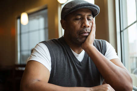 Portrait of a mature African American man in deep thought.