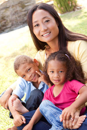 Mixed race mother and her children.