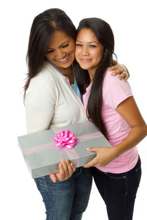Daughter giving a gift to her mom.