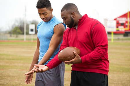 Coach training a high school athlete. Stock Photo