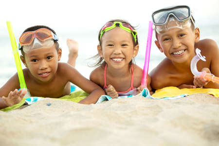 Asian kids playing on the beach. Stock Photo