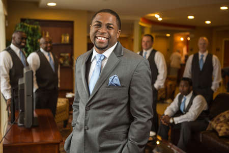 African American groom and groomsmen smiling. Banco de Imagens