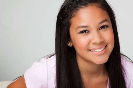 Asian teenage girl smiling. Foto de archivo