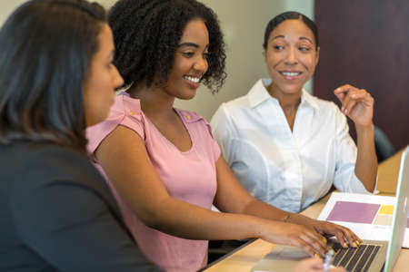 Diverse group of business woman working in an office.