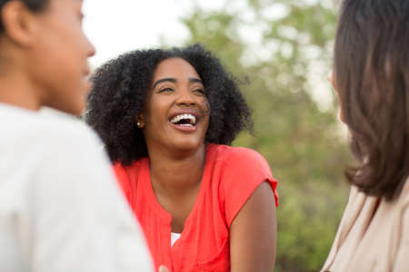 Multi-ethnic group of women laughing and talking.