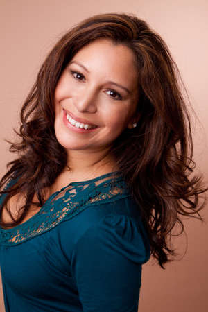 Beautiful Hispanic woman smiling looking at the camera.