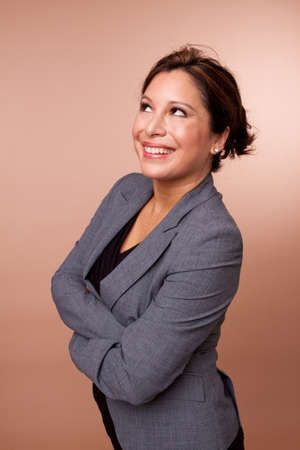 Hispanic businesswoman smiling and isolated on a background.