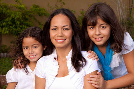 Happy Hispanic family laughing and smiling outside. Stock fotó