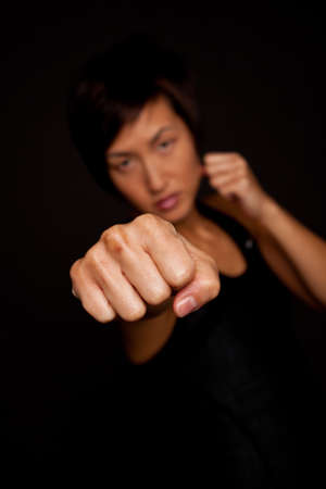 Portrait of an Asian woman practicing self defense.