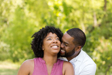 Happy African American couple laughing and smiling. Stock Photo