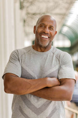 Happy mature African American man smiling outside. Stock Photo