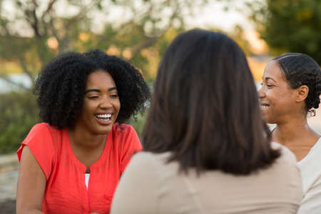 Diverse group of friends talking and laughing.