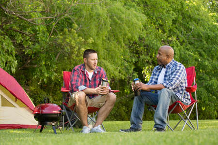 Multi-Ethnic group of friends talking and camping.