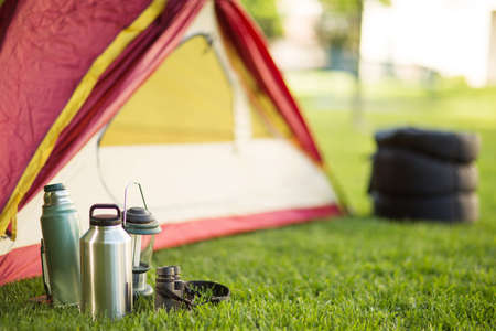 Camping background of a tent with copy space. Imagens