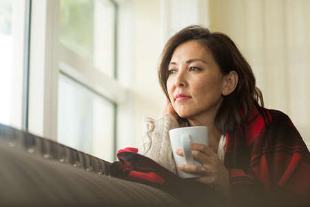 Portrait of a mature Asian woman in deep thought. 写真素材