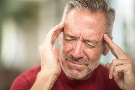 Mature man having a headache stock photo