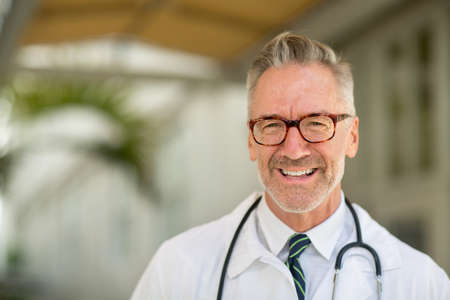 Portrait of a mature handsome doctor at a medical office.