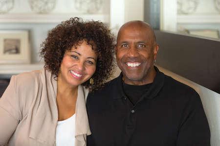 Portrait of a mature mixed race couple smiling.