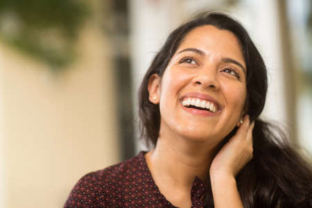 Confident Hispanic woman laughing and smiling stock photo 写真素材