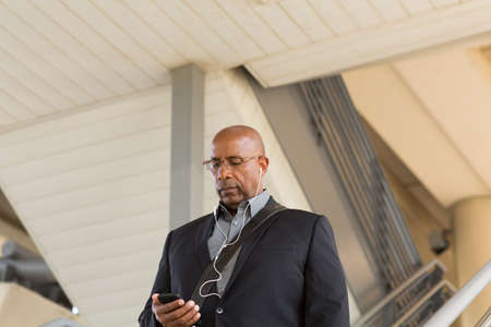 African American businessman checking his mobile phone.