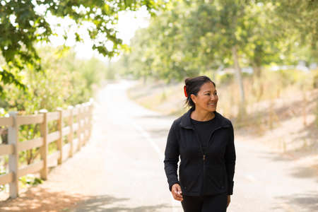 Portrait of a fit Asian woman exercising.
