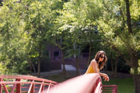 Portrait of a beautiful Hispanic woman standing on a bridge